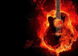 Burning guitar on a black font
