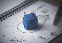 Blue paper on a picture of bulb